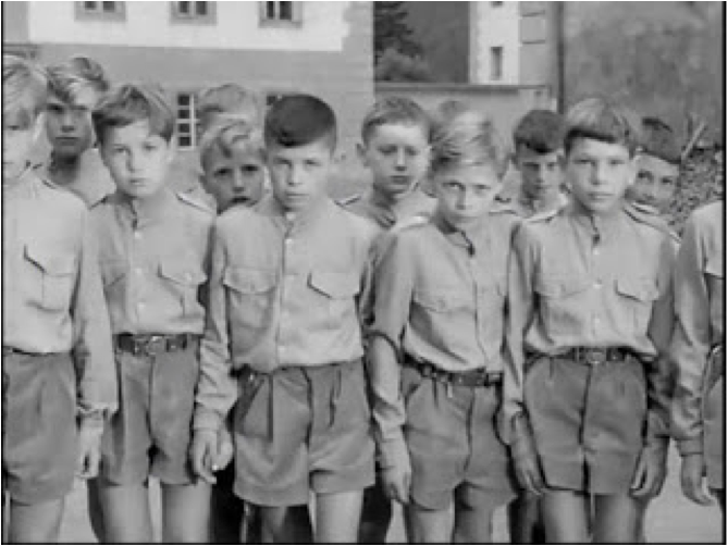 Film still from The Gamma People showing how Boronski's experimental children are dressed in a manner reminiscent of Nazi Germany's Hitler youth.