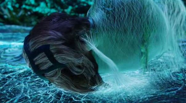 Screenshot: Avatar (2009). The dying Dr. Grace Augustin is embraced by Pandora to pass through Eywa and transfer all that she is into her Na'vi body.